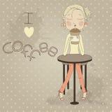 Gulligt flickasammanträde på tabellen som dricker kaffe. Il Arkivfoto