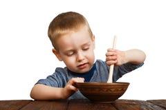 Gulligt isolerat blont äta för pojke arkivbilder