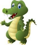 Gulligt krokodiltecknad filmanseende Royaltyfria Foton