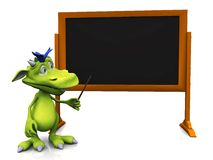 Gulligt tecknad filmmonster som pekar på den tomma blackboarden. Arkivbild