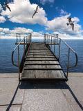 Gulls above pier in sea Royalty Free Stock Photos