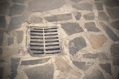 Gully on old town street Royalty Free Stock Images