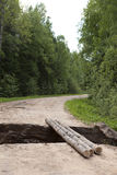 Gully which destroyed the road. Russia, rural areas Royalty Free Stock Image