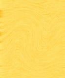 Gulna abstrakt bakgrund Arkivbild