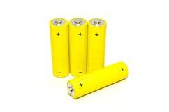 Gult batteri på vitbakgrund som isoleras Arkivfoton