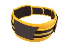 Gult brett bälte för att lyfta för vikt och powerlifting, knäppas som isoleras på isolerad vit bakgrund Arkivfoton