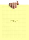 gult papper i handen som isoleras på vit bakgrund Arkivfoton
