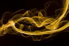 Gult rökabstrakt begrepp Arkivfoton