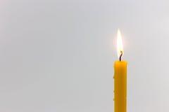 Gult stearinljus Fotografering för Bildbyråer