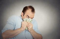Gulzige bankiers uitvoerende CEO werkgever, die dollarbankbiljetten houden Stock Afbeelding