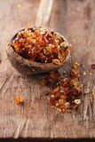 Gum arabic, also known as acacia gum - in  old wooden spoon Royalty Free Stock Photography