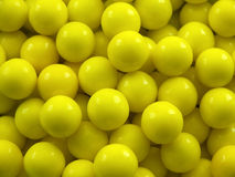 Gum Ball Background. Yellow gum ball background or texture royalty free stock photos