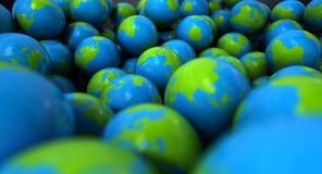 Gum Ball Earth Globes. An extreme closeup concept of a collection of gumballs resembling little earth globes Stock Photo