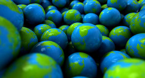 Gum Ball Earth Globes. An extreme closeup concept of a collection of gumballs resembling little earth globes Royalty Free Stock Photos