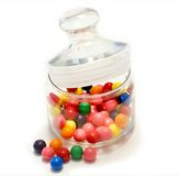 Gum balls. Colorful gum balls in a glass on a white background Royalty Free Stock Photo