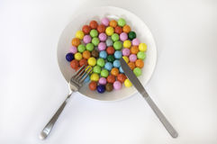 Gum Balls on the Plate with Knife and Fork. Royalty Free Stock Photo