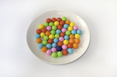 Gum Balls on the Plate with White Background. Royalty Free Stock Image
