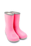 Gum boots. A pair of pink kids gum boots for rainy weather. Image isolated on white studio background Stock Photos