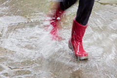 Gum boots in the rain Royalty Free Stock Photo