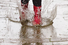 Gum boots in the rain Stock Photo