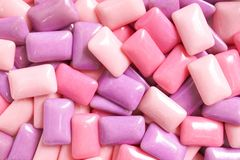 gum. colorful confectionary background of candy gums in different shades of pink and purple. royalty free stock image