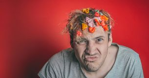 Gum in his head. Portrait of man with chewing gum in his head. Man with hair covered in food. stock photos