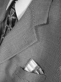 Gum in suit pocket. Business suit and tie with chewing gum in the breast pocket stock image