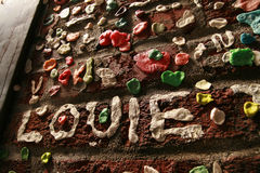 Gum Wall in Seattle Washington. Near Public Market Street with Louie written in gum royalty free stock photography