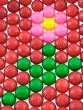 Gumball Flower. Pink flower made of gumballs surrounded by red gumballs Stock Images