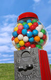 Gumball Machine. A gumball machine with a colorful nature background Royalty Free Stock Photography