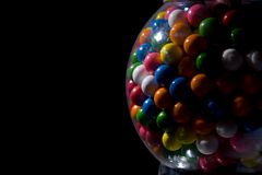 Gumball Machine. Gum-ball machine filled with gum-balls Stock Image