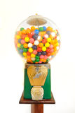 Gumball Machine. Antique gumball machine isolated on white stock images