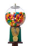 Gumball Machine. An antique gum ball machine isolated on white Stock Photos