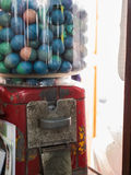 Gumball machine. Antique petite dispenser gumball machine, capsule toy for kids royalty free stock image