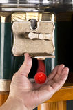 Gumball Machine. Gumball machine dropping red gumball royalty free stock photography