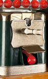 Gumball Machine. Gumball machine dropping red gumball royalty free stock image
