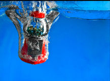 Gumball Machine In Water. Gumball Machine Dropping Into Water stock photography