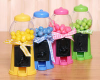 Gumball machines. Five gumball machines in different colors in a row Stock Image
