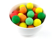 Gumballs. A bowl of pastel colored sour gumballs royalty free stock photography