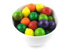 Gumballs. A bowl of fruit flavored gumballs royalty free stock photos