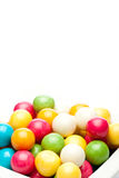 Gumballs. Many colored gumballs on a white background stock photo