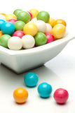 Gumballs. Many colored gumballs on a white background royalty free stock photos