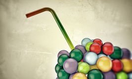 Gumballs. With straw in old grunge photo Royalty Free Stock Photo