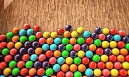 Gumballs. Many gumballs on wooden floor Stock Images