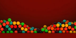 Gumballs. Many gumballs in a red exhibitor Royalty Free Stock Image