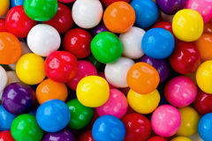 Gumballs. Background texture of several colored gumballs royalty free stock photo