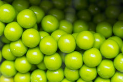 Gumballs Candy Machine. Close up of green candy gum balls in candy machine Stock Images