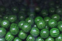 Gumballs Candy Machine. Close up of green candy gum balls in candy machine Stock Image