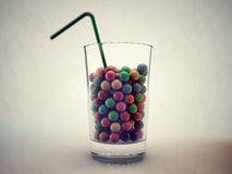 Gumballs in a glass Royalty Free Stock Photo