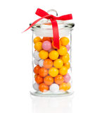 Gumballs in glass jar. Over white background royalty free stock photography